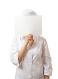 Woman nurse showing blank sign board, isolated. Royalty Free Stock Photo