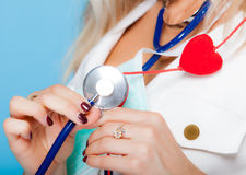 Woman in nurse suit with stethoscope and red heart. Healthcare Stock Photography