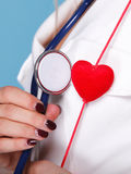Woman in nurse suit with stetoscope red heart Royalty Free Stock Images