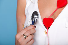 Woman in nurse suit with stetoscope red heart Stock Photos