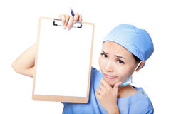 Woman nurse thinking showing clipboard Stock Photos