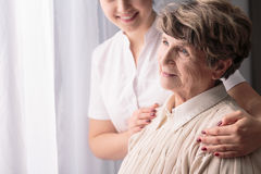 Woman in nursing home. Senior happy women in nursing home with her carer stock photo