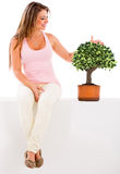 Woman nurturing a tree Stock Photography
