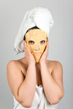 Woman with nutritious mask. Woman standing and hold with her hands a nutritious  mask for skin problems on her face,more spa photos in Spa,aromatherapy ,massage Stock Photo