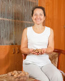 Woman with nuts Stock Photos