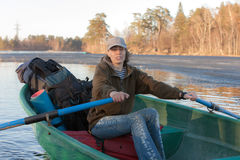 Woman with oars. In boat on lake Stock Photos