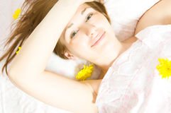 Woman ob bed Royalty Free Stock Image