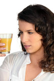 Woman observing orange juice Royalty Free Stock Photo
