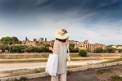 A woman observing Ruins of Circus Maximus royalty free stock images