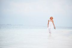 Woman on the ocean coast Stock Photography