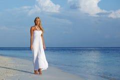 Woman on the ocean coast Stock Photos