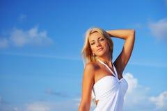 Woman on the ocean coast Stock Photo