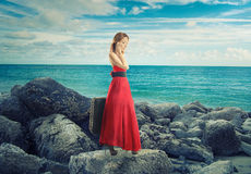 Woman by the ocean talking on phone Royalty Free Stock Photography