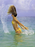 Woman in the ocean tossing her hair Royalty Free Stock Photography