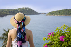 Woman and ocean view. A stylish woman looking at a beautiful ocean view Royalty Free Stock Photos