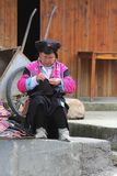 Woman Of The Red Yao Hill Tribe In Traditional Costume Is Embroidering, Longji, China Stock Photo