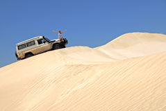 Woman With Off Road Car On Sand Dunes Royalty Free Stock Photo