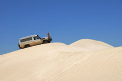Woman With Off Road Car On Sand Dunes Stock Photo