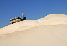 Woman With Off Road Car On Sand Dunes Stock Image