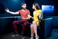 Woman offended by a boyfriend playing video games royalty free stock images