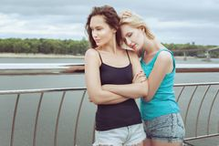 Woman offended at her friend. Woman offended at her friend, she was a frown on his face Royalty Free Stock Images