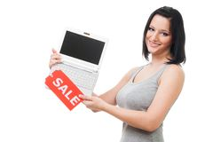 Woman offer laptop sale. Smile and look at camera Stock Photography