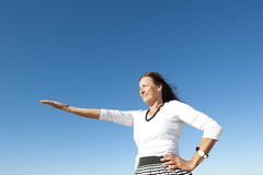 Woman offering with arm up stock images