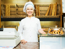 Woman offering bread in bakery Royalty Free Stock Photo
