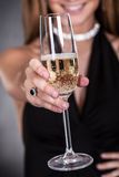 Woman Offering Champagne Royalty Free Stock Images