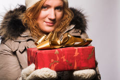 Woman offering a christmas gift Stock Photo
