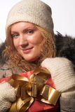 Woman offering a christmas gift Stock Image