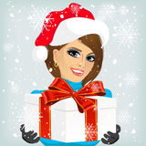 Woman offering a christmas gift Stock Photography