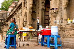 Woman offering cold drinks and snacks in a fort. Ujjain, India - 16th July 2016: Woman offering cold drinks, refreshments and snacks at the historic Ahilya fort Stock Photography