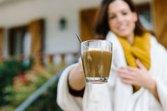 Woman offering cup of coffee on autumn Royalty Free Stock Image