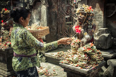 Woman offering flower to a god Royalty Free Stock Images