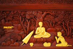 Woman offering food to monk carvings in temple of thailand royalty free stock photos
