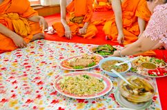 Offering foods to monks in Thai culture royalty free stock image