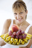 Woman offering fruit Stock Photo