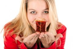 Woman offering gift Stock Images