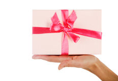 Woman offering a gift Stock Photos