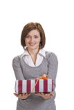Woman offering a gift box Stock Photos