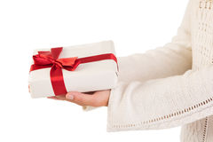 Woman offering a gift box Stock Image