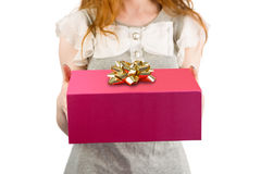 Woman offering a gift box Royalty Free Stock Image