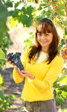 Woman offering grape in vineyard Royalty Free Stock Image