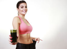 Woman offering grenn juice Stock Photos