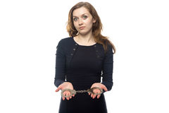 Woman offering handcuffs Royalty Free Stock Photos