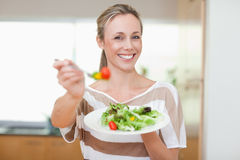 Woman offering healthy salad Royalty Free Stock Photo