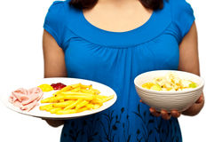 Woman offering healthy and unhealthy option Stock Photo