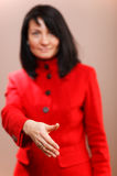 Woman offering her hand in a handshake Stock Photography