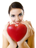 Woman offering her heart Stock Photo